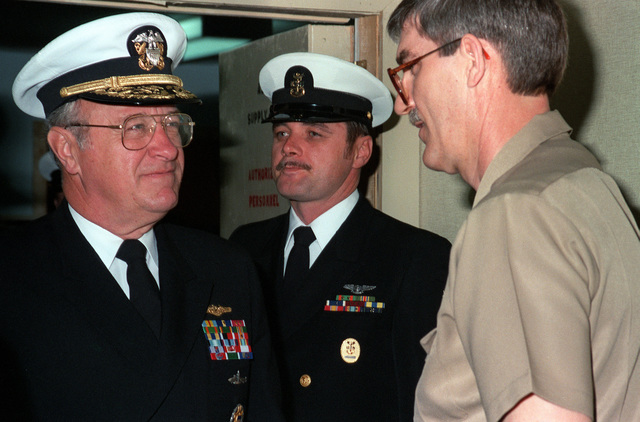CHIEF of Naval Operations Adm. Carlisle A.H. Trost, left, pauses to speak to a sailor during his tour of air station facilities