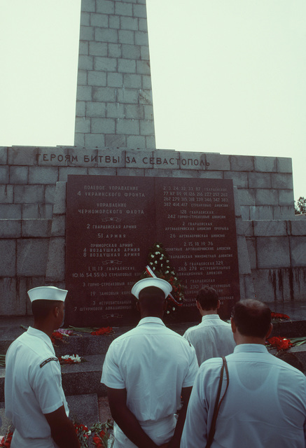 American sailors lay a wreath at the monument to Sevastopol's war heroes. The Aegis guided missile cruiser USS THOMAS S. GATES (CG 51) and the guided missile frigate USS KAUFFMAN (FFG 59) are making the second goodwill visit by American warships to a Soviet port since World War II