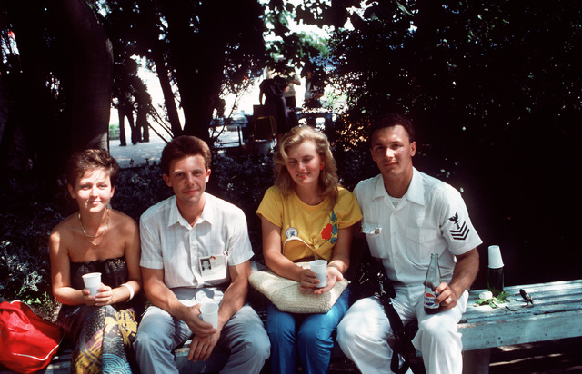 An American Sailor shares a Pepsi and the shade of a park bench with friends during the goodwill visit of the guided missile frigate USS KAUFFMAN (FFG 59) and the Aegis guided missile cruiser USS THOMAS S. GATES (CG 51).  It is the second goodwill visit to a Soviet port by American naval vessels since World War II
