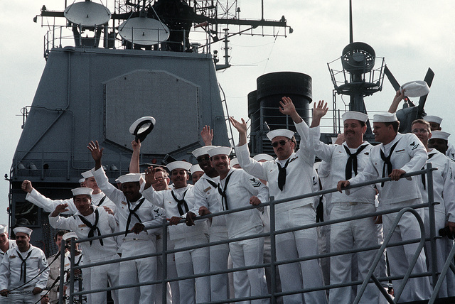 Sailors at the rail of the Aegis guided missile cruiser USS THOMAS S. GATES (CG-51) wave good-bye to well-wishers after making, along with the guided missile frigate USS KAUFFMAN (FFG-59), the second goodwill visit to a Soviet port by U.S. warships since World War II
