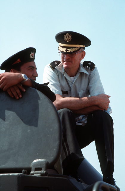 US defense attache Brigadier General (BGEN) Gregory Govan, perched next to the open hatch of a Soviet BTR-60PB amphibious armored personnel carrier, speaks with a Soviet naval infantryman (Marine) inside.  Govan traveled with the guided missile frigate USS KAUFFMAN (FFG 59) and the Aegis guided missile cruiser USS THOMAS S. GATES (CG 51) which are making the second goodwill visit to a Soviet port by US naval vessels since World War II