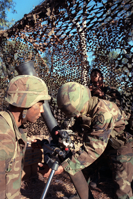 A member of 4th Bn., 87th Inf., 25th Inf. Div. (Light), prepares an M-252 81mm mortar for a fire mission during the joint Australian/U.S. Exercise Kangaroo '89