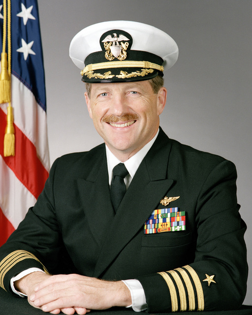Captain (CAPT) Frederick H. Hauck, USN (covered)