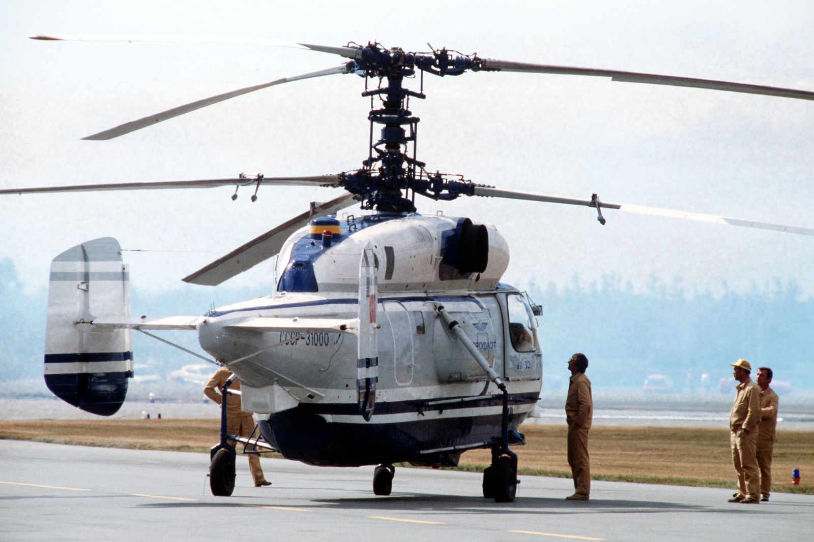 Ground crewmen look over a Soviet Ka-32 Helix helicopter during Airshow Canada '89