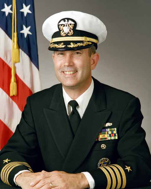 Captain (CAPT) David E. H. Secrest, USN (covered)