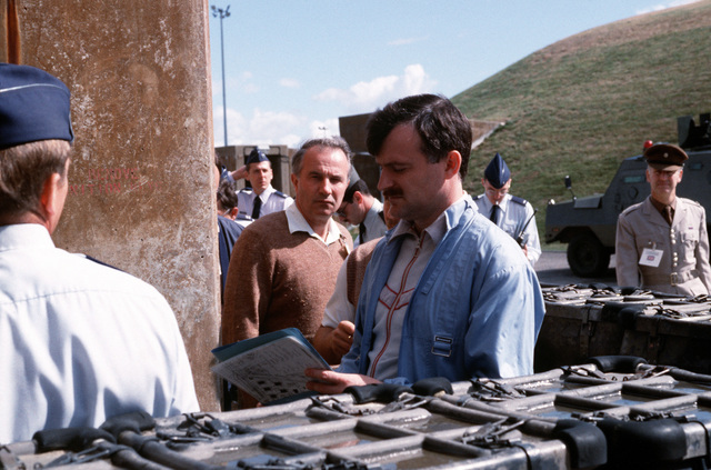 A Soviet inspector reviews a checklist as his team goes through a weapons storage area to verify NATO compliance with the terms of the Intermediate Range Nuclear Forces (INF) Treaty