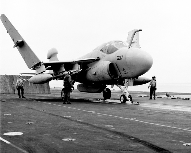 A Tactical Electronic Warfare Squadron 309 (VAQ-309) EA-6A Intruder aircraft is hooked to the catapult aboard the flight deck of the nuclear-powered aircraft carrier USS ENTERPRISE (CVN 65) during Reserve Carrier Air Wing 30 annual training operations off the coast of Southern California