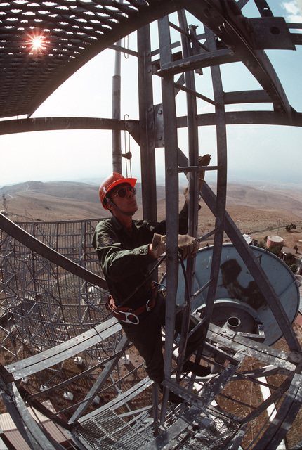 TSGT Jon Reeves of the 2003rd Communications Group (2003rd CG) climbs a microwave antenna tower at a communications facility run by Detachment 4, 2003rd CG. Elma Dag is located about 20 miles east of Ankara, Turkey