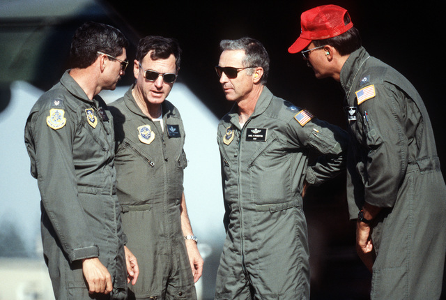 The pilots and co-pilots of C-130 Hercules aircraft equipped with a modular airborne firefighting system (MAFFS) gather at Geiger Field. They are, from left to right: LT. COL. Mark Brophy, COL. Any Bozeman, LT. COL. Dan Pemberton and LT. COL. Tom Bellen. The four are among those fighting the nearby White Mountain complex fire