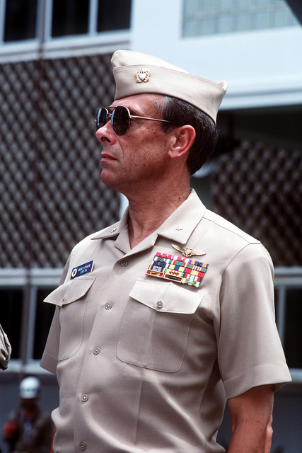 RADM (lower half) Henri B. Chase III, Commander, Amphibious Group 1/Task Force 76, stands at attention during a ceremony marking the opening the combined Thai/U.S. joint exercise Thalay Thai '89