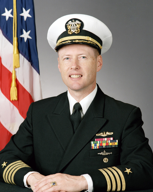 Captain (CAPT) Wade H. Taylor, USN (covered)