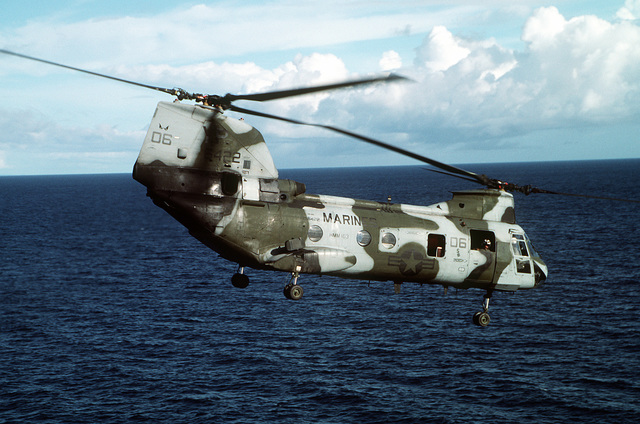 A CH-46E Sea Knight helicopter flies over the gulf after taking off from the amphibious assault ship USS TARAWA (LHA-1) during the combined Thai/U.S. joint exercise THALAY THAI '89. The helicopter is from Marine Medium Helicopter Squadron 163 (HMM-163), the reinforced aviation combat element of the 11th Marine Expeditionary Unit (11th MEU)
