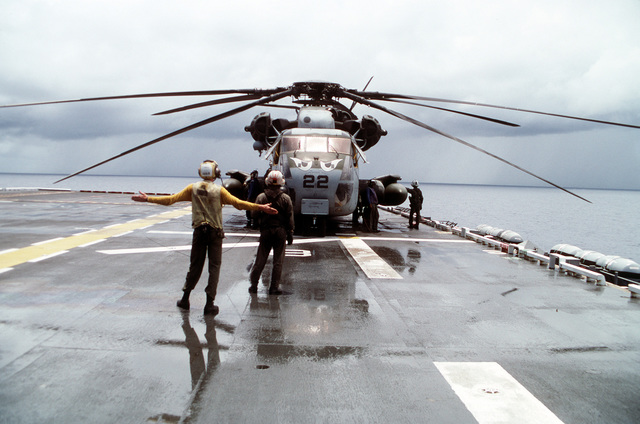 A CH-53E Super Stallion helicopter is prepared for flight aboard the amphibious assault ship USS TARAWA (LHA-1) during the combined Thai/U.S. joint exercise Thalay Thai '89. The helicopter is assigned to , the reinforced aviation combat element of the 11th Marine Expeditionary Unit (11th MEU)