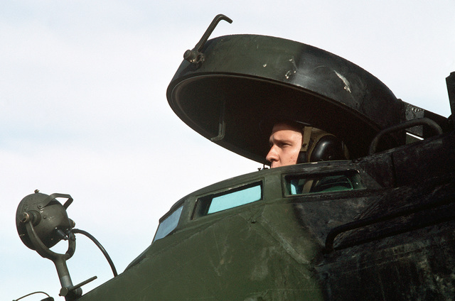 A Marine of the 11th Marine Expeditionary Unit looks out the hatch of his AAVP6A1 amphibious assault vehicle during the initial assault phase of the joint Thai/US exercise THALAY THAI '89