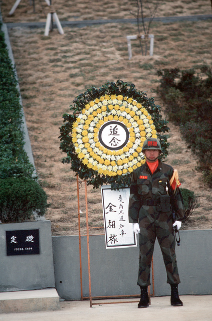 A Royal Thai Marine stands guard at a memorial during the joint Thai/US combined exercise THALAY THAI '89