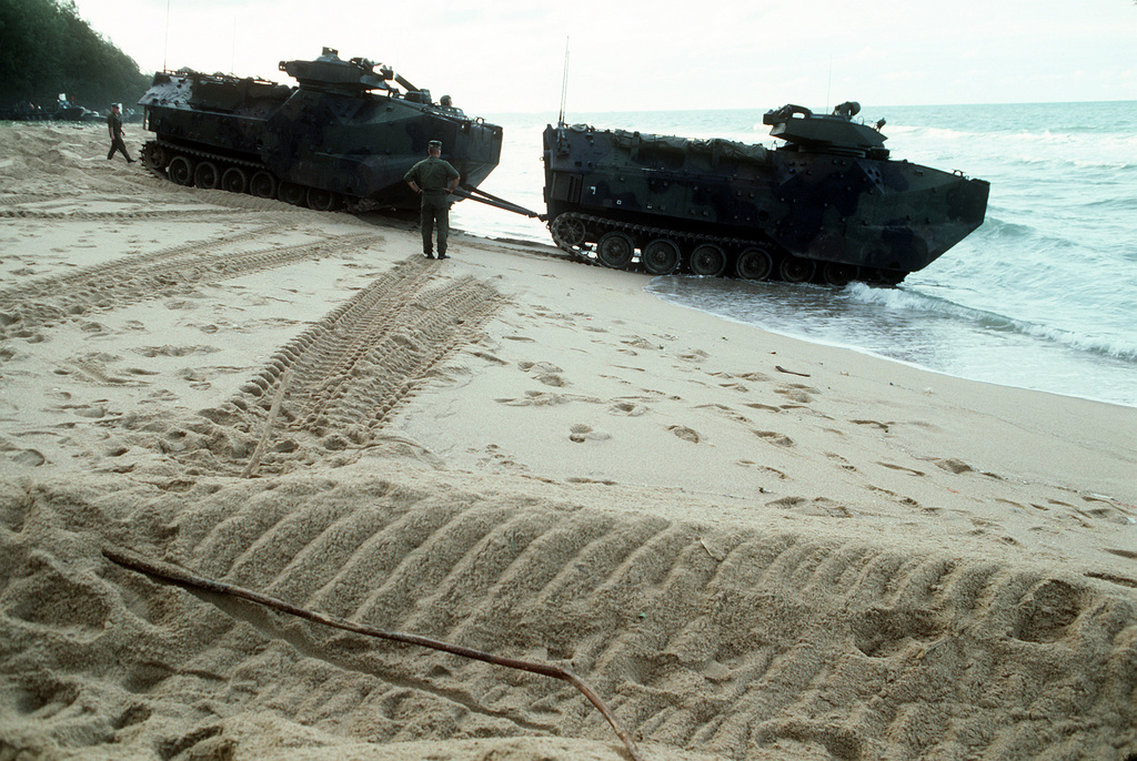 An 11th Marine Expeditionary Unit (11th MEU) AAVP-7A1 amphibious assault vehicle (AAV) tows a second AAVinto the surf near Pattaya Beach during the combined Thai/U.S. joint exercise Thalay Thai '89