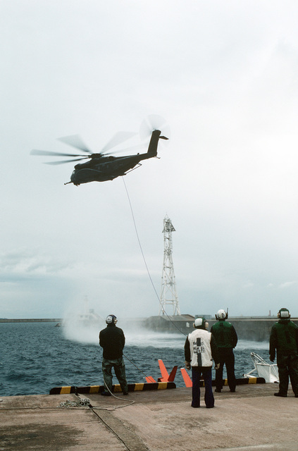 An MH-53E Sea Dragon helicopter tows a Mark 105 hydrofoil minesweeping sled during the joint Thai/US combined exercise THALAY THAI '89