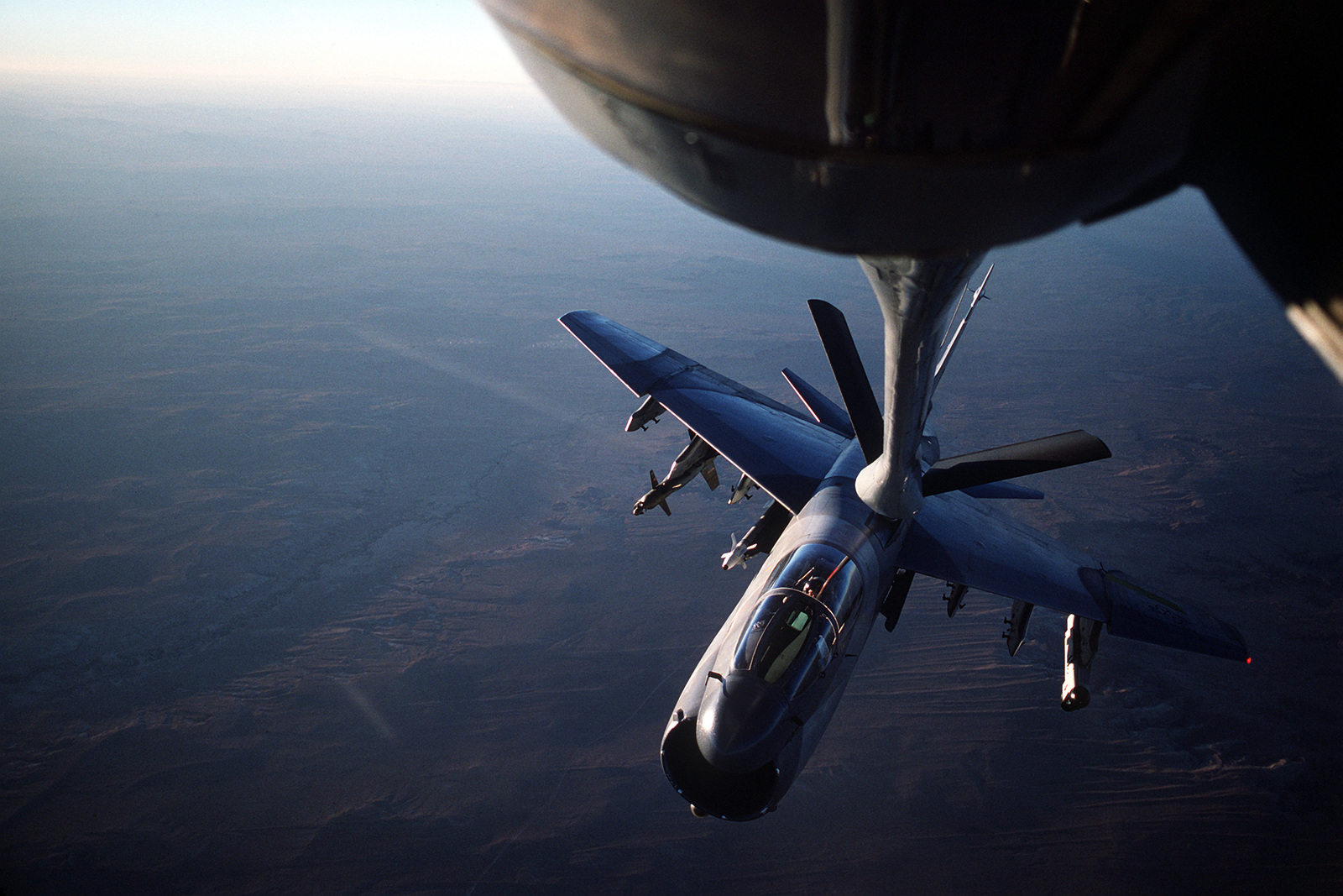 An Ohio Air National Guard A-7D Corsair II aircraft is refueled by a KC-135 Stratotanker aircraft during exercise Quick Force. The U.S. Central Command exercise is designed to increase combat capabilities and provide a realistic combat environment simulating areas such as Southwest Asia, the Middle East and the Horn of Africa. The refueling mission is taking place at the Utah Test and Training Range