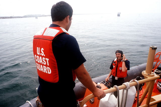 Coast Guardsmen in an inflatable boat participate in PACEX '89