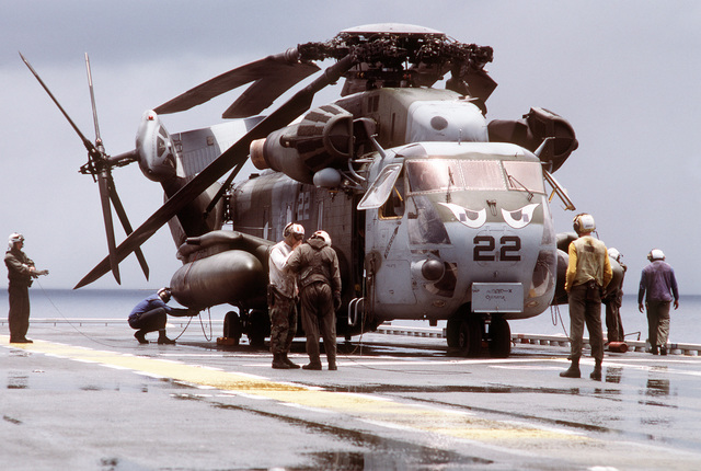Flight deck personnel assist the crew of a CH-53E Super Stallion helicopter being readied for flight aboard the amphibious assault ship USS TARAWA (LHA-1) during the combined Thai/U.S. joint exercise Thalay Thai '89. The helicopter is assigned to , the reinforced aviation combat element of the 11th Marine Expeditionary Unit (11th MEU)
