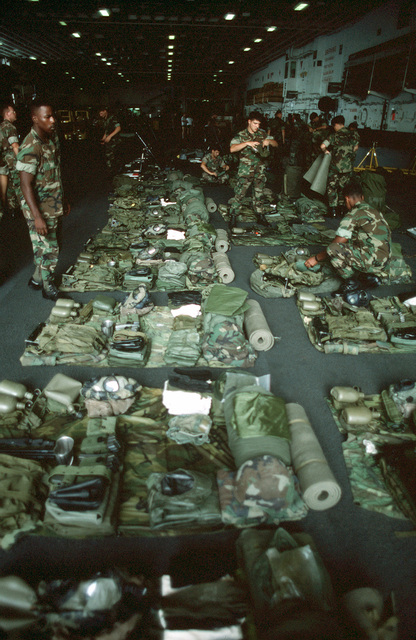 Marines of the 11th Marine Expeditionary Unit prepare for an equipment inspection aboard the amphibious assault ship USS TARAWA (LHA 1) during the joint Thai/US exercise THALAY THAI '89