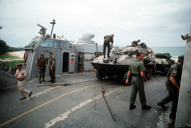 On the shoreline near Pattaya Beach, Marines of the 11th Marine Expeditionary Unit (11th MEU) prepare to move their LAV-25 light armored vehicles off of the air cushion landing craft LCAC-2 during the combined Thai/U.S. joint exercise Thalay Thai '89