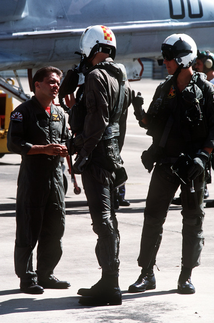 Two pilots from Fleet Composite Squadron 5 (VC-5) talk with another squadron member before a mission during the combined Thai/U.S. joint exercise Thalay Thai '89