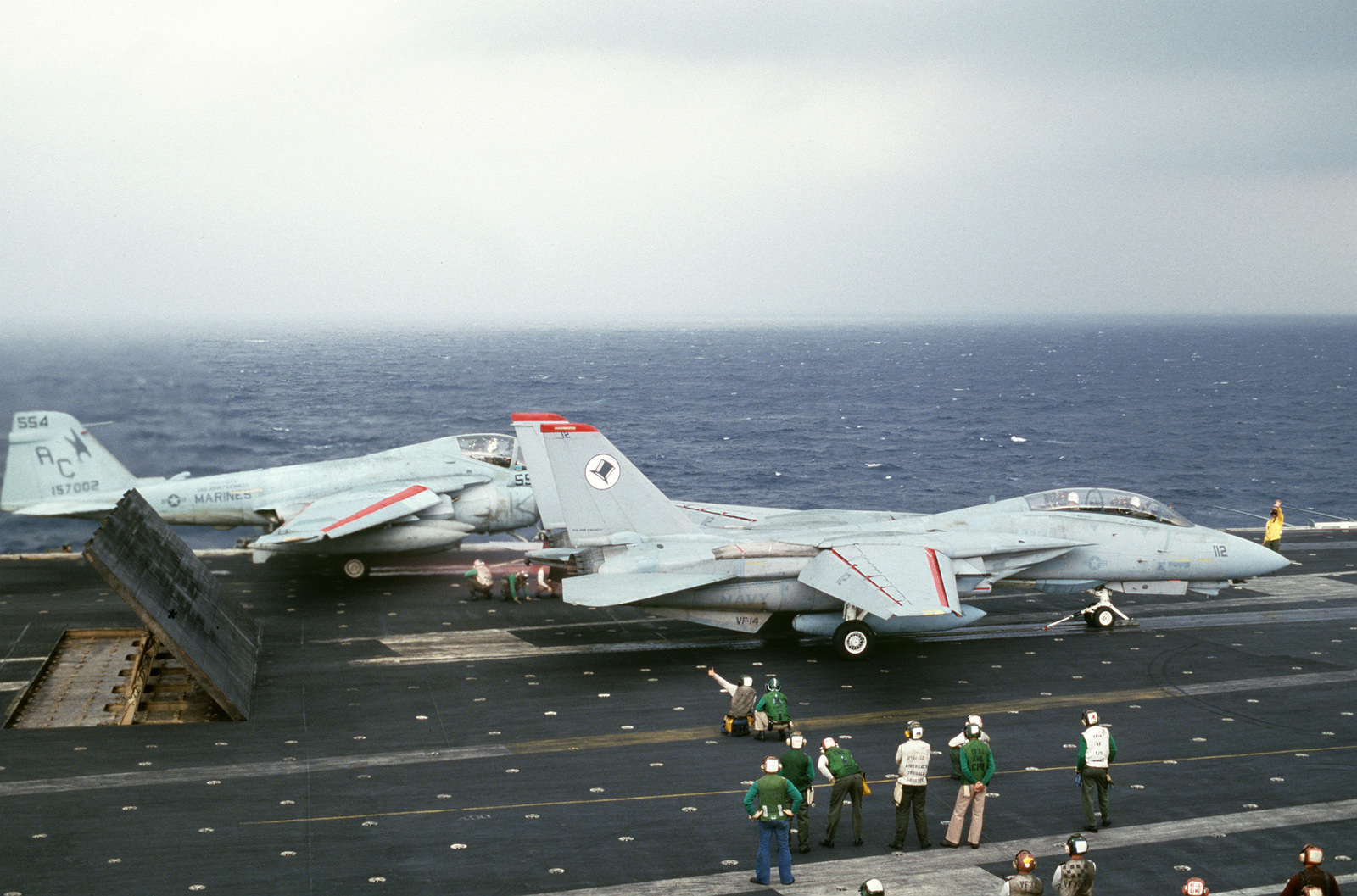 A Fighter Squadron 14 (VF-14) F-14A Tomcat aircraft and an A-6E Intruder aircraft are launched from the flight deck of the Aircraft Carrier USS JOHN F. KENNEDY (CV 67)