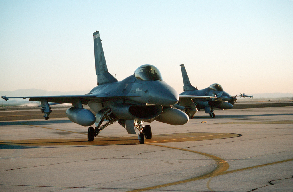 F-16C Fighting Falcon aircraft of the Air Force Reserve's 944th Tactical Fighter Group stand by for a preflight check