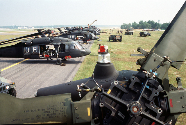 Soldiers from Co. A, 1ST Aviation Bn., 82nd Airborne Div., prepare their UH-60A Black Hawk (Blackhawk) helicopters to be loaded aboard U.S. Air Force cargo aircraft during exercise Market Square III