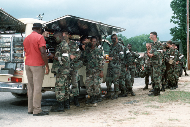 Soldiers line up for a snack during exercise Market Square III