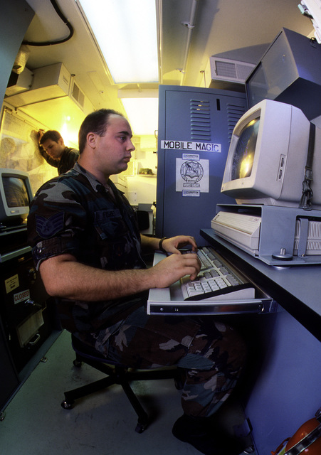 SSGT Mike Fischer inputs data on a Tactical Electronic Reconnaissance (TEREC) ground processor during Display Determination '89, a combined NATO exercise focusing on the defense of southern Europe