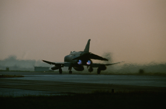 A 26th Tactical Reconnaissance Wing RF-4C Phantom II aircraft rolls down a runway as it departs on a mission during the U.S. Air Forces in Europe (USAFE) exercise Display Determination '89