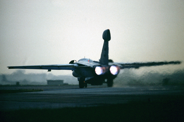 A 42nd Electronic Combat Squadron EF-111A Raven aircraft rolls down a runway as it departs on a mission during the U.S. Air Forces in Europe (USAFE) exercise Display Determination '89