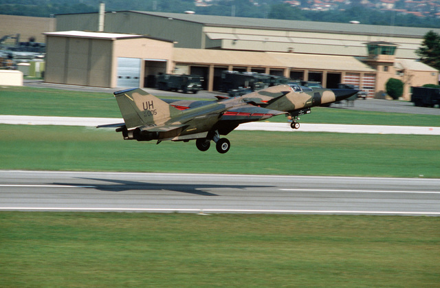 A 55th Tactical Fighter Squadron F-111E aircraft lifts off from the runway as it departs on a mission during the U.S. Air Forces in Europe (USAFE) exercise Display Determination '89