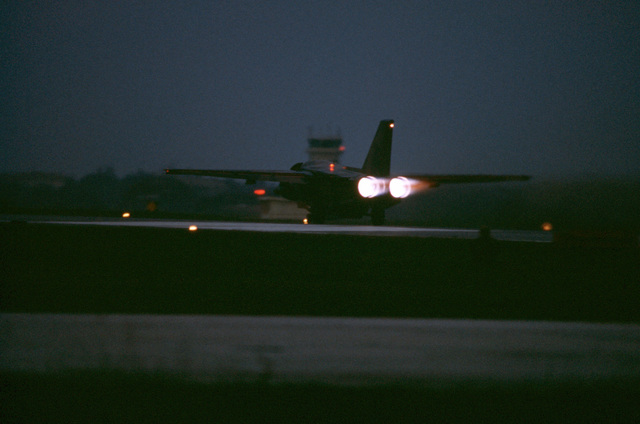 A 55th Tactical Fighter Squadron F-111E aircraft rolls down a runway in the darkness as it departs on a mission during the U.S. Air Forces in Europe (USAFE) exercise Display Determination '89
