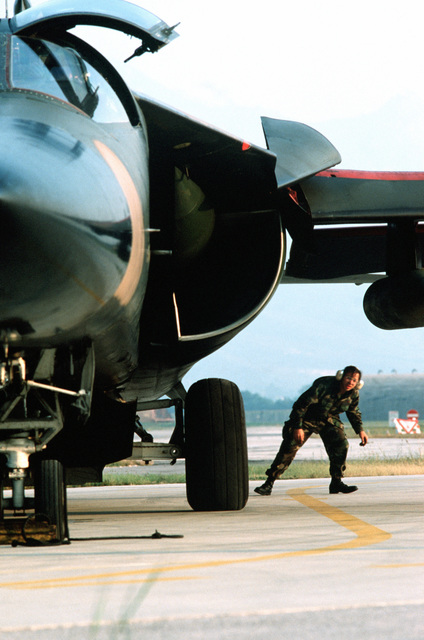 A member of the 42nd Aircraft Maintenance Unit conducts a final pre-launch check of a 55th Tactical Fighter Squadron F-111E aircraft during the U.S. Air Forces in Europe (USAFE) exercise Display Determination '89