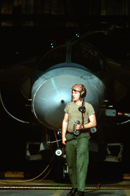 A1C Richard L. Bigham of the 42nd Aircraft Maintenance Unit prepares a 42nd Electronic Combat Squadron EF-111A Raven aircraft for flight during the U.S. Air Forces in Europe (USAFE) exercise Display Determination '89