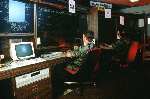 SSGT William G. Finch, left, of the 20th Tactical Fighter Wing coordinates his unit's maintenance efforts from the base's maintenance operations center during the U.S. Air Forces in Europe (USAFE) exercise Display Determination '89