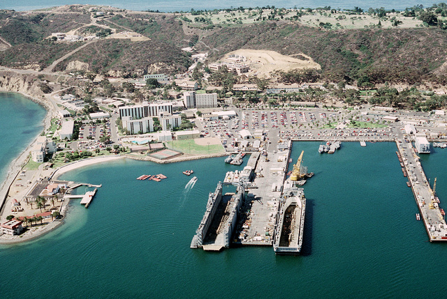 An aerial view of the Point Loma submarine base with two floating dry docks, center, during PACEX '89
