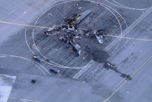 An aerial view of the remnants of an Alaska Air National Guard KC-135E Stratotanker aircraft that exploded and burned while taxiing to a parking area. Two of the aircraft's seven crewmen were killed; the others sustained only minor injuries