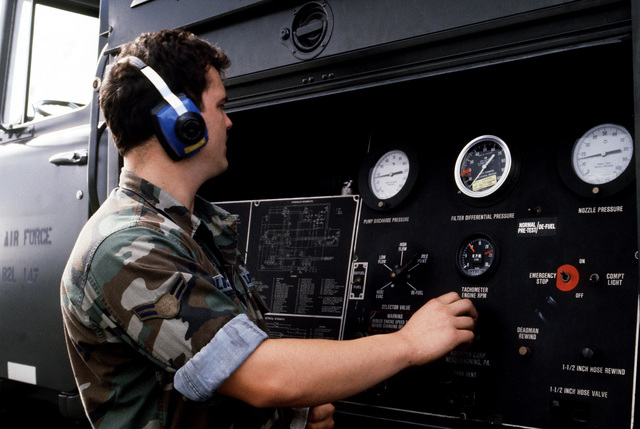 A1C Chris H. Luckie adjusts the throttle on the pump engine aboard an aircraft refueling truck during the NATO exercise Tactical Fighter Weaponry '89