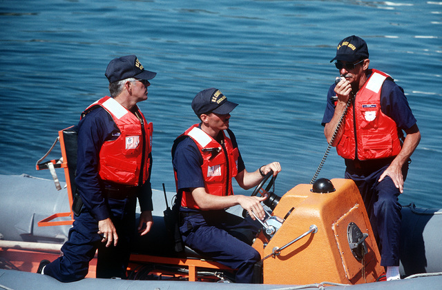 Coast Guardsmen in a small boat participate in a PACEX '89 drug interdiction exercise