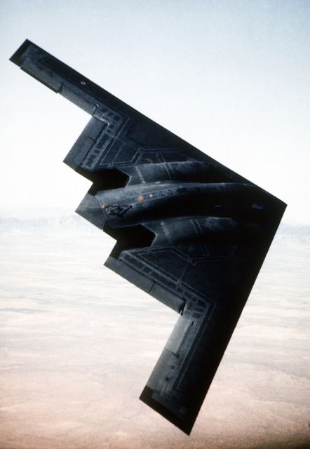 An overview in-flight image of the B-2 Bomber in its fifth test flight. The flight lasted one hour and seventeen minutes. Northrop CHIEF Test Pilot Bruce Hinds and Air Force LT. COL. John Small of the B-2 Combined Test Force were at the controls. The first five test flights were designed to expand the flight envelope, demonstrate the handling qualities of the aircraft while flying in the air refueling position and validate the proper function of the aircraft's subsystems
