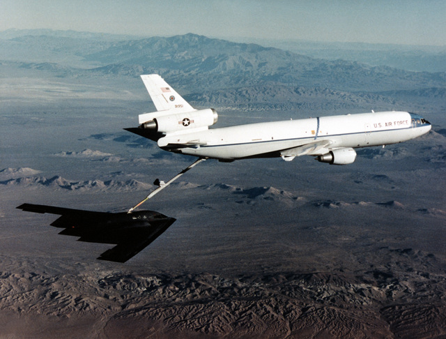During the B-2's fifth test flight it is being refueled by a KC-10. The flight lasted one hour and seventeen minutes. Northrop chief test pilot Bruce Hinds and AIr Force LT. COL. John Small of the B-2 Combined Test Force were at the controls. The test flights were designed to expand the flight envelope, demonstrate the handling qualities of the aircraft while flying in the air refueling position and validate the proper fuction of the aircraft' s subsystems