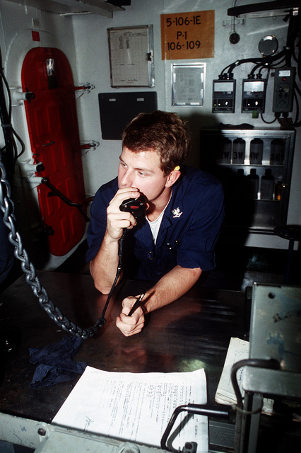 A boiler technician aboard the aircraft carrier USS Constellation (CV-64) passes along some information while the ship is underway during PACEX '89