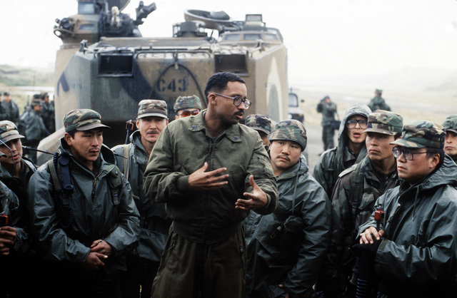 Marine SGT Robert Johnson conducts a class on the AAVP-7A1 amphibious assault vehicle for members of Co. C, 2nd Bn., 297th Infantry Group (Scout), Alaska National Guard, during exercise Kernal Potlatch '89