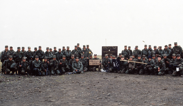 The members of Co. C, 2nd Bn., 297th Infantry Group (Scout), Alaska National Guard, gathers for a group photograph following exercise Kernal Potlatch '89