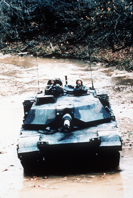 Soldiers drive an Army M1A1 main battle tank through a stream