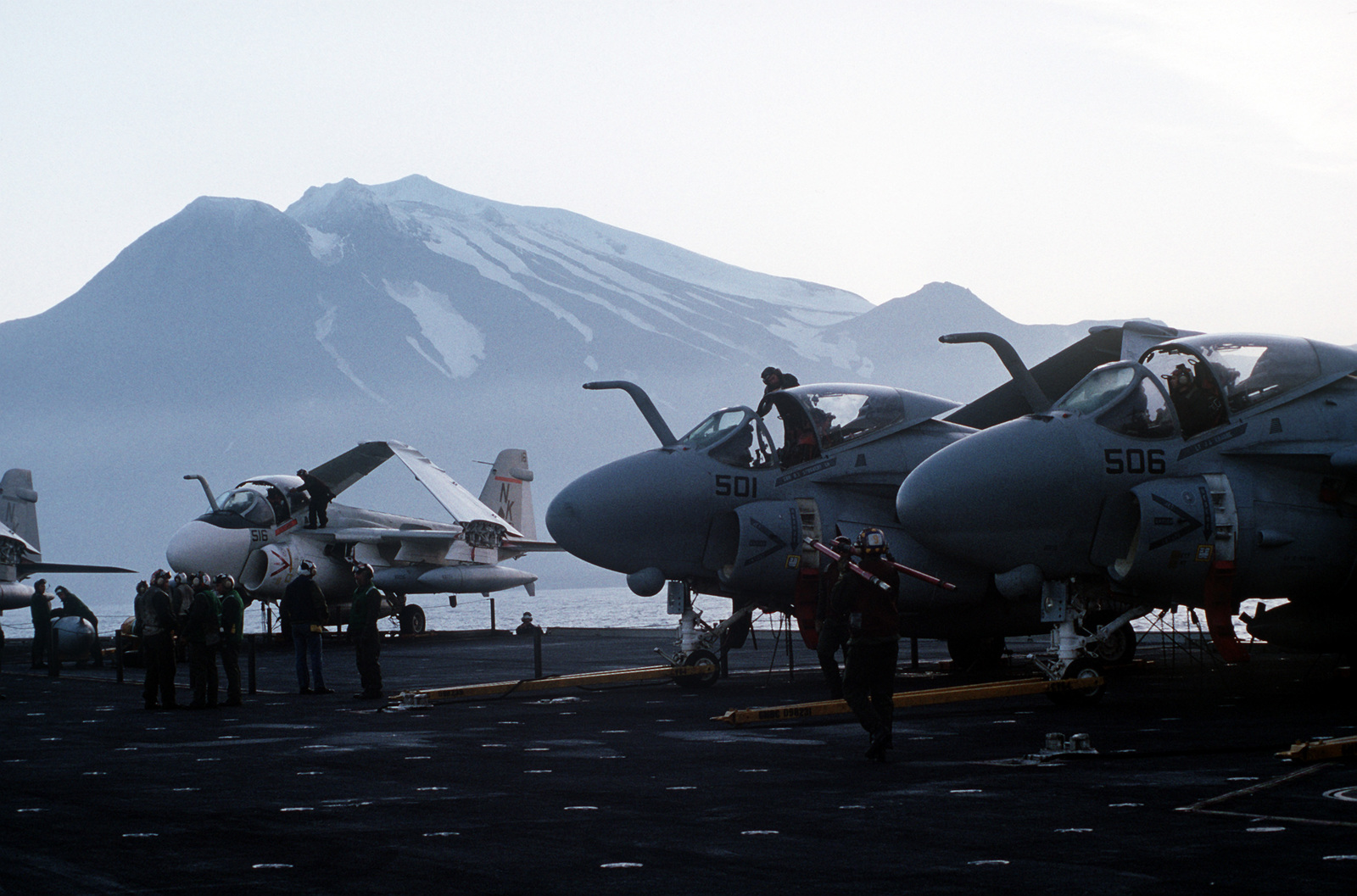 Flight deck crew members service A-6E Intruder aircraft aboard the aircraft carrier USS CONSTELLATION (CV 64) during PACEX '89